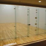 movable glass wall for racquetball courts and squash courts